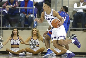 TCU guard Desmond Bane (1) drives inside past Kansas guard Isaiah Moss (4) during the second half of an NCAA college basketball game, Saturday, Feb. 8, 2020 in Fort Worth, Texas. Kansas won 60-46. (AP Photo/Ron Jenkins)