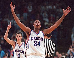 Former Jayhawks Paul Pierce and Ryan Robertson decked out in the home white of the 1990s. (File photo)