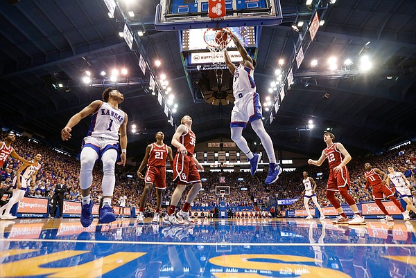 Kansas center Udoka Azubuike (35) delivers a dunk after a lob from Kansas guard Devon Dotson (1) during the first half on Saturday, Feb. 15, 2020 at Allen Fieldhouse.