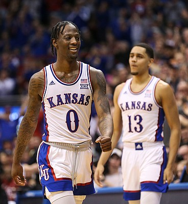 Kansas guard Marcus Garrett (0) smiles after a big dunk from Kansas center Udoka Azubuike (35) during the second half on Saturday, Feb. 15, 2020 at Allen Fieldhouse.