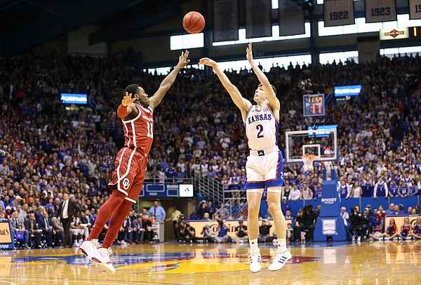 Kansas guard Christian Braun (2) hoists a three before Oklahoma guard De'Vion Harmon (11) during the first half on Saturday, Feb. 15, 2020 at Allen Fieldhouse.
