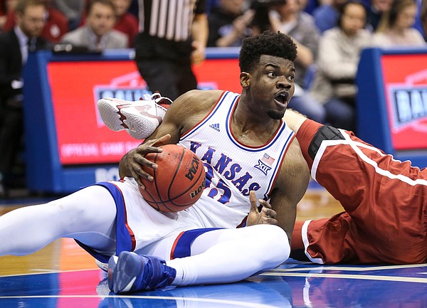 Kansas center Udoka Azubuike (35) comes away with a ball on the floor during the first half on Saturday, Feb. 15, 2020 at Allen Fieldhouse.