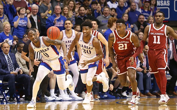 Kansas guard Marcus Garrett (0) comes away with a steal from Oklahoma during the first half on Saturday, Feb. 15, 2020 at Allen Fieldhouse.