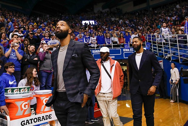 Marcus Morris makes his way onto the court followed by Mario Little and his brother Markieff Morris prior to the halftime ceremony.