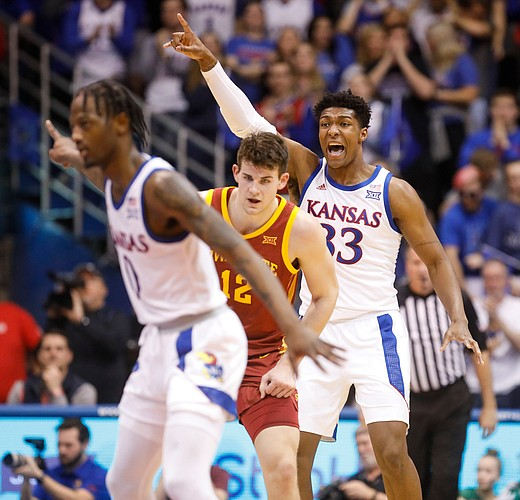 Kansas forward David McCormack (33) alerts his teammates on defense during the first half on Monday, Feb. 17, 2020 at Allen Fieldhouse.