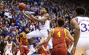 Kansas guard Ochai Agbaji (30) coasts to the bucket between the Iowa State defense during the first half on Monday, Feb. 17, 2020 at Allen Fieldhouse.