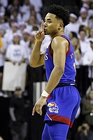 Kansas guard Devon Dotson gestures to the crowd after a three point basket against Baylor during the first half of an NCAA college basketball game on Saturday, Feb. 22, 2020, in Waco, Texas. (AP Photo/Ray Carlin)