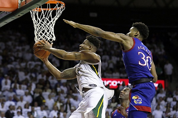 Baylor guard Mark Vital, left, goes to the basket on Kansas guard Ochai Agbaji, right, during the second half of an NCAA college basketball game on Saturday, Feb. 22, 2020, in Waco, Texas. (AP Photo/Ray Carlin)