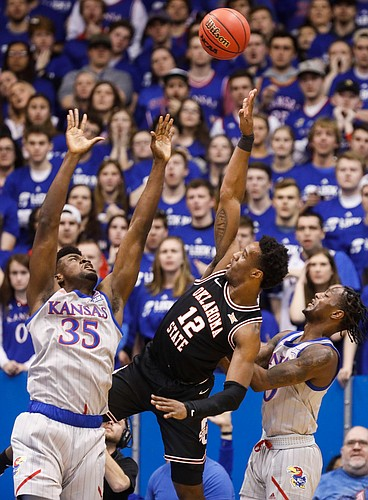Kansas center Udoka Azubuike (35) and Kansas guard Marcus Garrett (0) contest a shot from Oklahoma State forward Cameron McGriff (12) during the first half on Monday, Feb. 24, 2020 at Allen Fieldhouse.