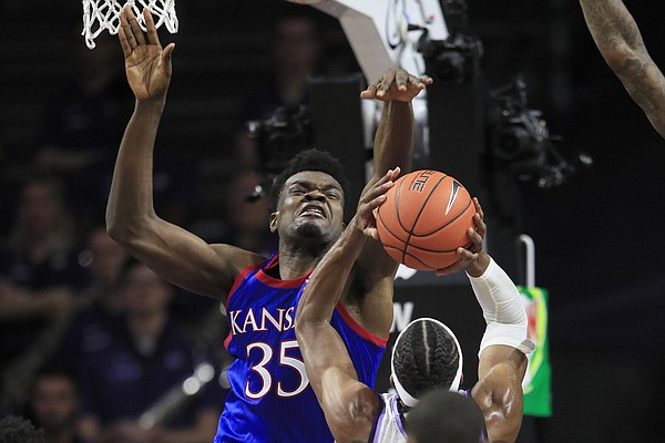 Kansas center Udoka Azubuike (35) blocks a shot by Kansas State forward Xavier Sneed during the first half of an NCAA college basketball game in Manhattan, Kan., Saturday, Feb. 29, 2020. (AP Photo/Orlin Wagner)