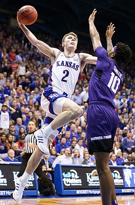 Kansas guard Christian Braun (2) elevates to the bucket against TCU forward Diante Smith (10) during the second half, Wednesday, March 5, 2020 at Allen Fieldhouse.