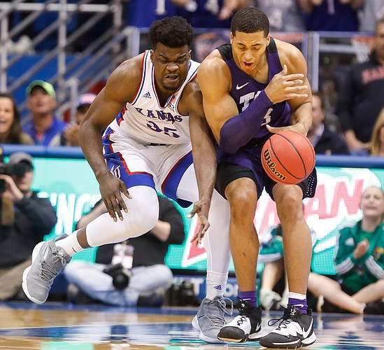 Kansas center Udoka Azubuike (35) collides with TCU forward Jaedon LeDee (23) while competing for a ball during the first half, Wednesday, March 5, 2020 at Allen Fieldhouse.