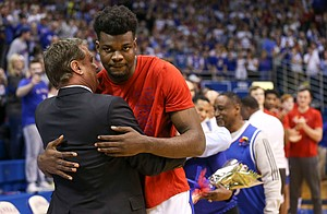 Kansas head coach Bill Self hugs Kansas center Udoka Azubuike (35) as he is introduced to the Allen Fieldhouse crowd on Senior Night.