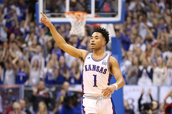 Kansas guard Devon Dotson (1) celebrates a three pointer during the first half, Wednesday, March 4, 2020 at Allen Fieldhouse.
