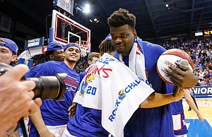 Kansas center Udoka Azubuike (35) gets hugs from his teammates after his Senior Night speech, Wednesday, March 5, 2020 at Allen Fieldhouse.