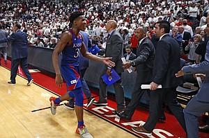 Kansas' Ochai Agbaji (30) celebrates after an NCAA college basketball game against Texas Tech, Saturday, March 7, 2020, in Lubbock, Texas. (AP Photo/Brad Tollefson)