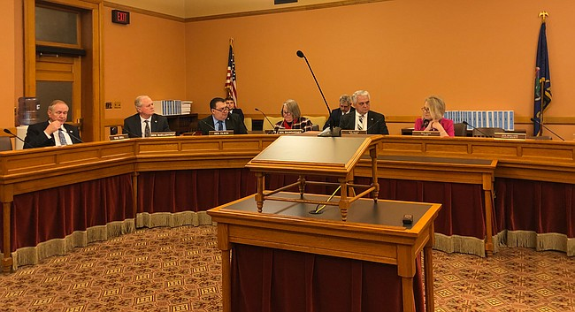 Members of the Kansas Senate Commerce Committee confer on March 10, 2020, at the Statehouse in Topeka.