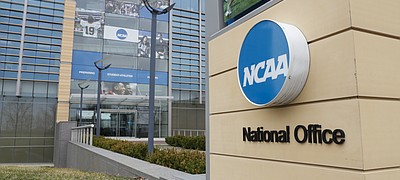 The NCAA headquarters in Indianapolis is pictured, Thursday, March 12, 2020. (AP Photo/Michael Conroy)