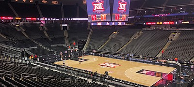 Ball boys shoot around on the Sprint Center floor in Kansas City. Mo., Thursday morning, March 12, 2020, in place of Texas and Texas Tech, the teams that should have been playing in the Big 12 basketball tournament at the time of this photograph. The tournament was canceled Thursday morning as a result of the coronavirus pandemic.