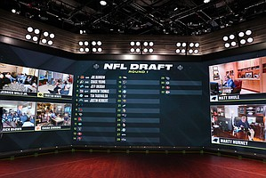 In a photo provided by ESPN Images, the first six selections in the NFL draft are displayed during ESPN's coverage of the NFL football draft, Thursday, April 23, 2020, in Bristol, Conn. (Allen Kee/ESPN Images via AP)