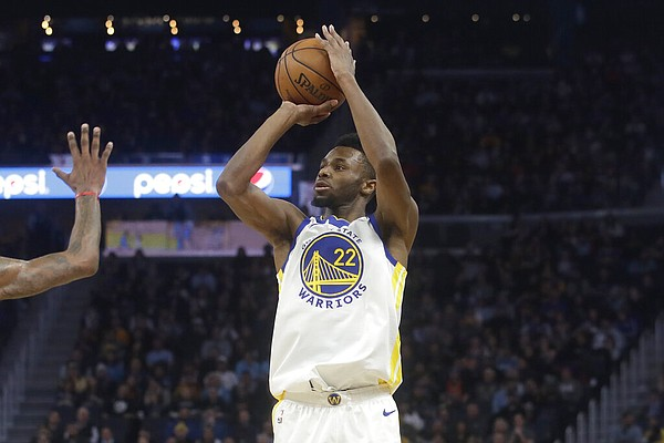 Golden State Warriors guard Andrew Wiggins (22) shoots against the Miami Heat during an NBA basketball game in San Francisco, Monday, Feb. 10, 2020. (AP Photo/Jeff Chiu)