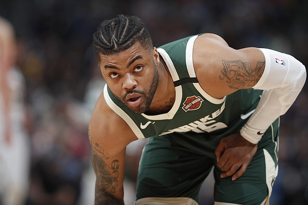 Milwaukee Bucks guard Frank Mason III looks to the bench for a play as he takes to the court in the first half of an NBA basketball game against the Denver Nuggets, Monday, March 9, 2020, in Denver. (AP Photo/David Zalubowski)