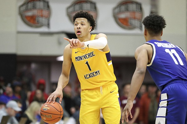 Montverde Academy's Cade Cunningham is shown in action against IMG Academy during a high school basketball game at the Hoophall Classic, Sunday, January 19, 2020, in Springfield, MA. (AP Photo/Gregory Payan)