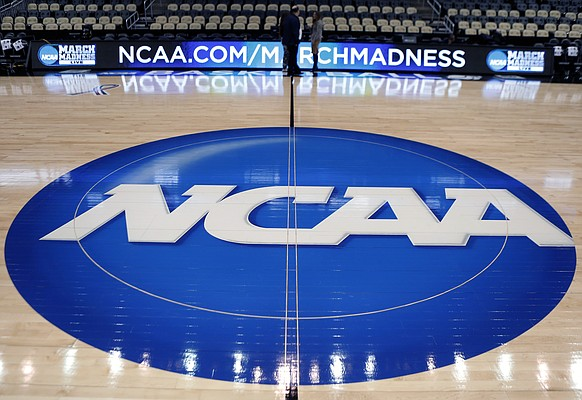In this March 18, 2015, AP file photo, the NCAA logo is displayed at center court at The Consol Energy Center in Pittsburgh.
