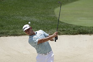 Gary Woodland hits from a bunker toward the first green during the third round of the Memorial golf tournament, Saturday, July 18, 2020, in Dublin, Ohio.