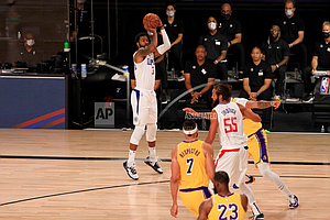 Los Angeles Clippers' Marcus Morris Sr. (31) shoots against the Los Angeles Lakers during the first quarter of an NBA basketball game Thursday, July 30, 2020, in Lake Buena Vista, Fla. (Mike Ehrmann/Pool Photo via AP)