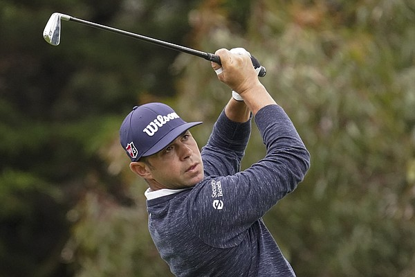 Gary Woodland watches his tee shot on the 11th hole during the first round of the PGA Championship golf tournament at TPC Harding Park Thursday, Aug. 6, 2020, in San Francisco. (AP Photo/Jeff Chiu)
