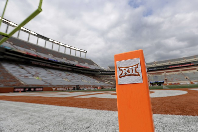 In this Oct. 7, 2017, file photo, a Big 12 pylon marks the end zone at Darrell K Royal Texas Memorial Stadium before an NCAA college football game between Texas and Kansas State in Austin, Texas.  (AP Photo/Eric Gay, File)