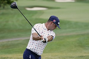 Gary Woodland tees on on the 10th hole during the second round of the BMW Championship golf tournament, Friday, Aug. 28, 2020, at Olympia Fields Country Club in Olympia Fields, Ill. (AP Photo/Charles Rex Arbogast)