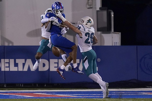 Coastal Carolina cornerback Derick Bush (23) and safety Shi'heem Watkins (28) break up a pass intended for Kansas wide receiver Andrew Parchment (4) during the first half of an NCAA college football game in Lawrence, Kan., Saturday, Sept. 12, 2020. (AP Photo/Orlin Wagner)