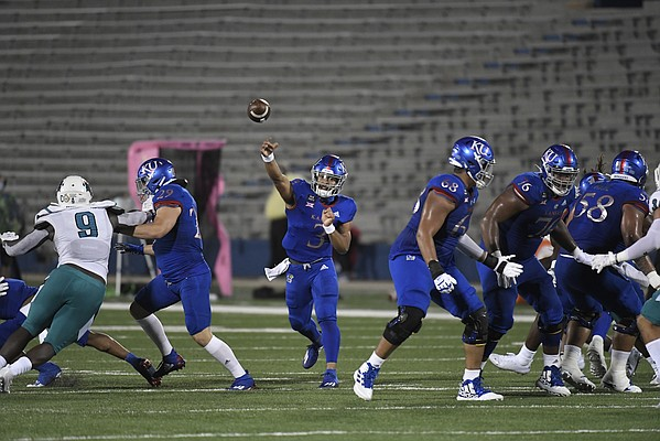 Kansas quarterback Miles Kendrick makes a throw on Sept. 12, 2020, versus Coastal Carolina at David Booth Kansas Memorial Stadium.