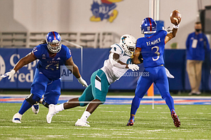 Coastal Carolina defensive end Tarron Jackson (9) puts a big hit on Kansas quarterback Miles Kendrick (3) in the fourth quarter of a college football game between the Chanticleers and Jayhawks on September 12, 2020 at Memorial Stadium. (Photo by Scott Winters/Icon Sportswire via AP Images)