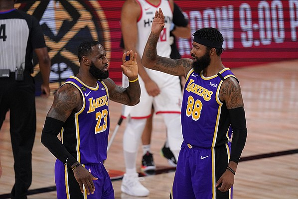 Los Angeles Lakers' LeBron James (23) celebrates with teammate Markieff Morris (88) during the first half of an NBA conference semifinal playoff basketball game against the Houston Rockets Friday, Sept. 4, 2020, in Lake Buena Vista, Fla. (AP Photo/Mark J. Terrill)
