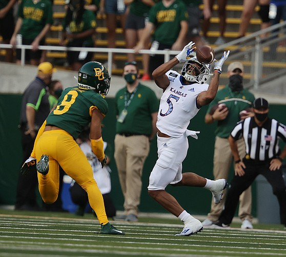 Kansas wide receiver Stephon Robinson Jr. pulls down a pass over Baylor safety Jalen Pitre, left, in the first half of an NCAA college football game, Saturday, Sept. 25, 2020, in Waco, Texas. (Rod Aydelotte/Waco Tribune Herald, via AP)