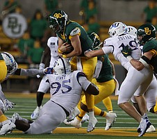 Baylor quarterback Charlie Brewer is tackled by Kansas defensive lineman DaJon Terry in the first half of an NCAA college football game, Saturday, Sept. 25, 2020, in Waco, Texas. (Rod Aydelotte/Waco Tribune Herald, via AP)