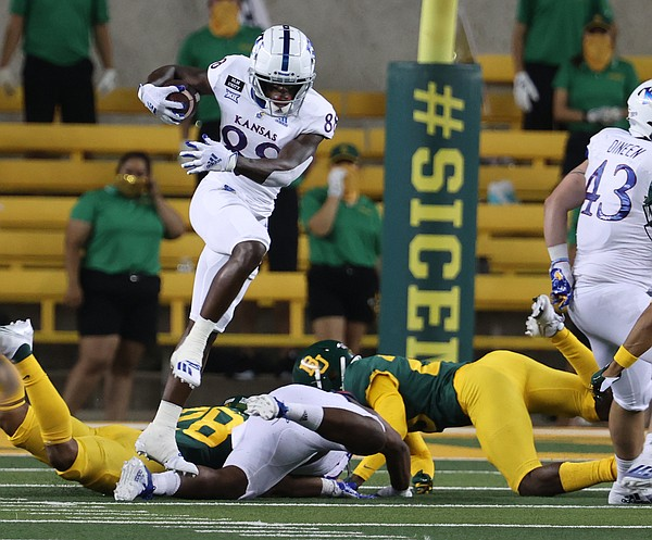 Kansas wide receiver Jamahl Horne (88) jumps over a defender during a kickoff return in the first half of an NCAA college football game, Saturday, Sept. 25, 2020, in Waco, Texas. (Rod Aydelotte/Waco Tribune Herald, via AP)