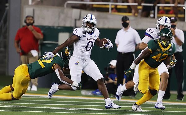 Kansas running back Velton Gardner slips past Baylor safety Jt Woods, left, in the first half of an NCAA college football game, Saturday, Sept. 25, 2020, in Waco, Texas. (Rod Aydelotte/Waco Tribune Herald, via AP)