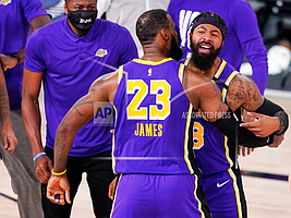 Los Angeles Lakers' forward LeBron James (23) celebrates with Markieff Morris (88) during a timeout in the second half of an NBA conference final playoff basketball game against the Denver Nuggets on Saturday, Sept. 26, 2020, in Lake Buena Vista, Fla. (AP Photo/Mark J. Terrill)