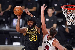 Los Angeles Lakers forward Markieff Morris (88) makes a pass in front of Miami Heat's Kelly Olynyk (9) during the first half of Game 2 of basketball's NBA Finals, Friday, Oct. 2, 2020, in Lake Buena Vista, Fla. (AP Photo/Mark J. Terrill)