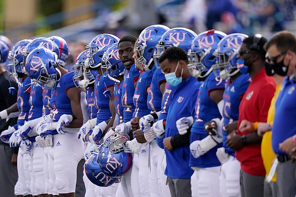 The Jayhawks line up for a moment of silence before their 47-7 loss to Oklahoma State on Saturday, Oct. 3, 2020 at David Booth Kansas Memorial Stadium.