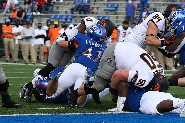 KU linebacker Nick Channel delivers a blow on an Oklahoma State ball carrier Saturday, Oct. 3, 2020. The Jayhawks lost to No. 17 OSU, 47-7.