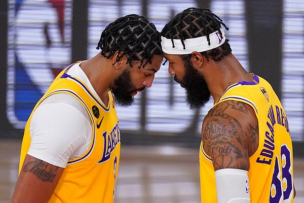 Los Angeles Lakers forward Anthony Davis, left, and forward Markieff Morris react during the second half in Game 4 of basketball's NBA Finals against the Miami Heat on Tuesday, Oct. 6, 2020, in Lake Buena Vista, Fla. (AP Photo/Mark J. Terrill)