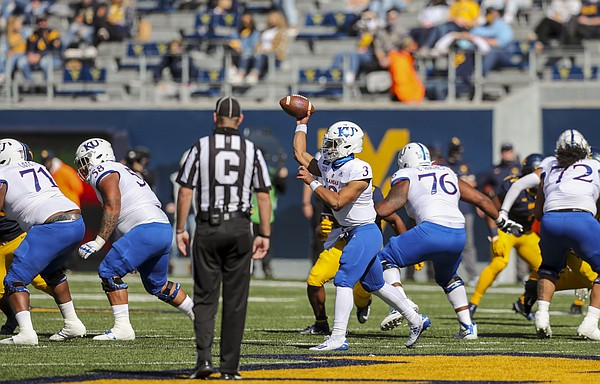 Oct 17, 2020; Morgantown, West Virginia, USA; Kansas Jayhawks quarterback Miles Kendrick (3) throws a pass during the first quarter against the West Virginia Mountaineers at Mountaineer Field at Milan Puskar Stadium.