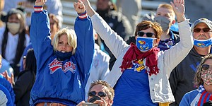 MORGANTOWN, WV - OCTOBER 17: Kansas Jayhawks fans celebrate a Jayhawks touchdown during the first quarter of the college football game between the Kansas Jayhawks and the West Virginia Mountaineers on October 17, 2020, at Mountaineer Field at Milan Puskar Stadium in Morgantown, WV.