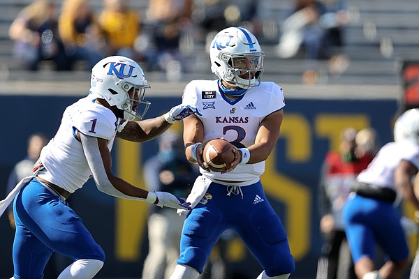 MORGANTOWN, WV - OCTOBER 17: Kansas Jayhawks quarterback Miles Kendrick (3) hands off to Kansas Jayhawks running back Pooka Williams Jr. (1) during the first quarter of the college football game between the Kansas Jayhawks and the West Virginia Mountaineers on October 17, 2020, at Mountaineer Field at Milan Puskar Stadium in Morgantown, WV.