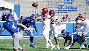 Oct 31, 2020; Lawrence, Kansas, USA; Iowa State Cyclones quarterback Brock Purdy (15) throws a pass during the first half against the Kansas Jayhawks at David Booth Kansas Memorial Stadium. Mandatory Credit: Denny Medley-USA TODAY Sports